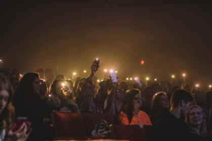 photo of people holding smartphones with flashlight